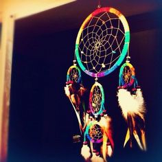 have a dream catcher? put string over it to make it have a pop of summer! or buy one already like this depending on how crafty you are about dream catchers :)