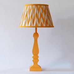 Hand-made ikat lampshades with a brightly painted matching lamp is it! As seen on @stylebeat @pentreathhall Photos courtesy of Melodi Horne