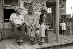"""October 1938. """"Porch of small Negro store near Jeanerette, Louisiana."""" 35mm negative by Russell Lee for the Farm Security Administration"""