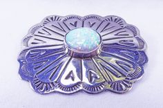 SoVintageous is offering this stunning vintage handmade Navajo sterling silver concho brooch pin with wonderful iridescent bezel-set opal cabochon.  While this is a vintage piece, it has never been wo