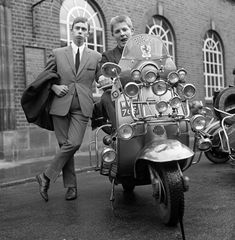 May 1965, Mods wearing suits and parka's on Motor Scooters covered with extra lights and wing mirrors