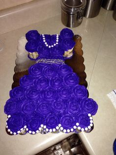 I made this for a little girls birthday. Sofia the first cupcake dress cake