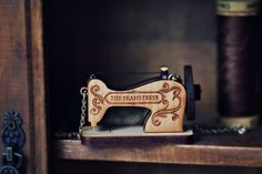 Vintage Sewing Machine wooden necklace  by StrangelyYours on Etsy, $35.00.  Wish I could sew just so I can justify wearing this necklace.
