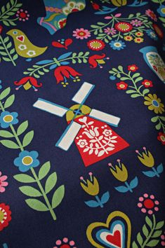 """Scandinavian fabric with line and rotational symmetry.  (Description by someone who knows much more about these things than I do--I just look and say """"pretty!"""")"""