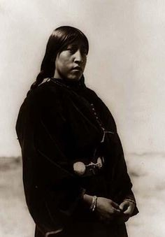 Here we present a stunning image of an Arapaho Girl Three-quarter-length Portrait Standing. It was taken in 1910 by Edward S. Curtis.    The image shows a nice outdoor picture of this girl.    We have created this collection of images primarily to serve as an easy to access educational tool. Contact curator@old-picture.com.