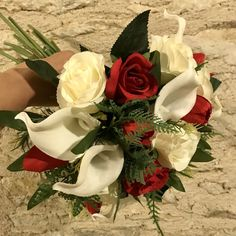 A wedding bouquet of red white and ivory roses tulips and calla Artificial Wedding Bouquets, Artificial Silk Flowers, Ivory Roses, Red Tulips, Flower Bouquet Wedding, Ribbon Bows, Red And White, Floral Wreath, Bridesmaid