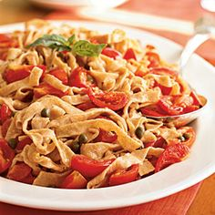 The nutty, slightly sweet flavor of whole wheat flour is a tasty addition to a basic pasta recipe. Look for the smallest sweet tomatoes you can find for this simple sauce. Substitute grated orange rind for the lemon, if you prefer.