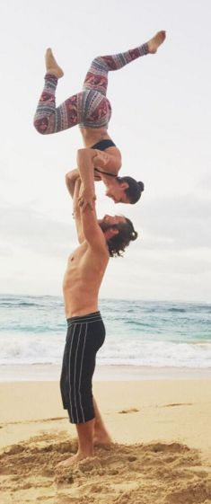 Experiment with couples acro yoga on the beach