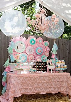 """The backdrop was a work in progress,"" Miranda says. ""I wanted the colors to pop but not stand out way too much. I spent all week before the party working on the each of the pinwheels until the backdrop was just right."" Source: Whimsically Detailed"