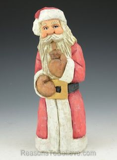 """""""Santa taking a moment with his favorite pipe. A hand crafted Santa Claus figure, carved from solid wood. Designed, carved by hand, painted, finished and signed by Russell Scott."""""""