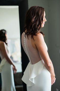 Sheer button back wedding dress: http://www.stylemepretty.com/pennsylvania-weddings/philadelphia/2016/02/05/philadelphia-greenhouse-wedding/   Photography: Robert and Kathleen - http://www.robertandkathleen.com/