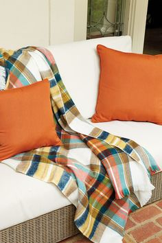 Throw blankets and outdoor pillows are colorful and inviting.
