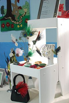 Vertical Craft show display with Goodwill finds for fascinators
