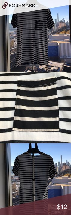 MEN'S - White and black stripped T-Shirt MEN'S - White and black stripped T-Shirt. Unknown brand as the label has been removed. Shirts Tees - Short Sleeve