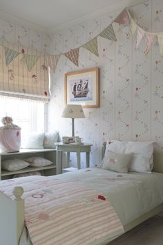 Use susie watson designs rosie mix floating wallpaper to create the ultimate childrens bedroom or playroom. It features elephants and penguins floating down in a delicious pallette of Pinks, Reds, Duck Eggs and Straw. #susiewatsondesigns #childrensrooms #susiewatson