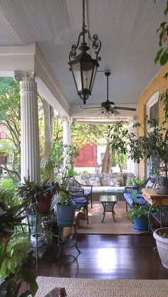 Great porch with cool lanterns!  | Beall Mansion An Elegant Bed and Breakfast Inn, Alton Illinois #outdoorlights #outdoorlighting