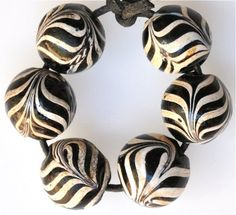 Matched large rare Venetian feather beads, great condition - Size: 16 to 17mm Date: Mid to late 1800s