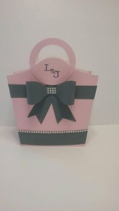 This beautiful tote is 5 12 W. on the bottom , 8 W on the top, 2 12 D and 912 H . with the handle. Paper Gift Box, Paper Gifts, Decorated Gift Bags, Card Making Templates, Paper Purse, Craft Bags, Craft Items, Birthday Cards, Diy And Crafts