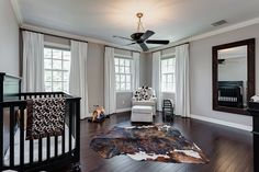 Child's Play A child's bedroom is outfitted with dark wood furniture and a trendy cowhide rug.