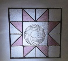 This stained glass panel uses a little  amber glass plate for the centerpiece of a whimsical flower. Description from uk.pinterest.com. I searched for this on bing.com/images