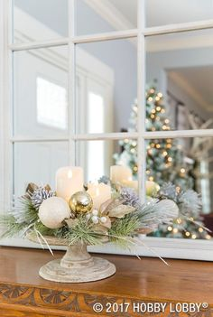 For Christmas centerpieces that are festive and elegant, arrange floral picks, ornaments and candles on a cake stand!