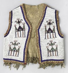 A Sioux beaded boy's vest Fully beaded on front and back in characteristic geometric devices, striped about the perimeter, fringed along the lower hem. length 18in