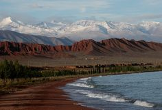 "The Issyk Kul lake was formed about 800000 yrs ago. Situated on the height of 1609 m above sea level, the area of the Kirghiz ""sea"" -  668м. deep. 80 rivers run on picturesque gorges to Issyk Kul, from high mountain ranges Tian-Shan. Issyk-Kul has not equal in the world among high-mountainous lakes on depth and volume of water.    Issyk Kul means « hot lake » in  Turkic, because the lake does not freeze over even in the coldest winters"