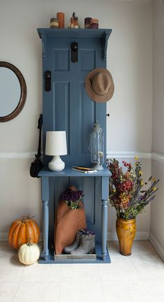 DIY Hall Tree Made From A Door ~ Here's how to turn an old door into an attractive and very useful hall tree. This is a terrific storage solution for coats, boots, hats and more in the entryway or mudroom. It's made from an old panel door with door and cabinet hardware as hooks. It's a fun and totally doable DIY project. Just follow our step-by-step tutorial.