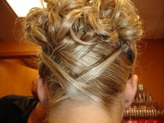 Bridesmaid hair? Maybe the back looking like this with another bun style instead of this?