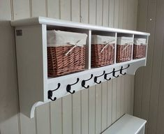 A coat rack which includes fitted baskets with lots of room for both storage and display - An attractive addition to any hallway, cloakroom, bedroom or bathroom - Solid wood with no assembly required, fittings are ready attached - Cast Iron double hooks will hold plenty of coats, scarves and leads - Hand made to last in the UK - Can be tailored to fit your requirements if the standard sizes do not suit. The 672mm width comes with 2 baskets, 972mm comes with 3 and 1122mm has 4. It loo...