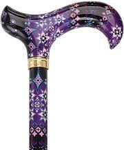 """Royal Canes Pretty Purple Designer Adjustable Derby Walking Cane with Engraved C by Royal Canes. $33.50. Tip Size: 16. Adjustable-height mechanism is sturdy and easy-to-use.. High-definition pattern provides an extremely acute level of detail.. Durable aluminum shaft will last for years to come.. Maximum Cane Height: adj. from 29"""" - 38"""" inches. This chic cane has an assortment of simple geometric shapes arranged over a dark background that is just the right touch of whimsy mee..."""