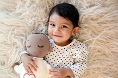 Smiling cutie with her tanned Lulla Doll. (Article about the Lulla Doll, sleep and safety in Fréttatíminn (NewsTime) Iceland)