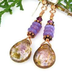 The exquisite VISIONS OF VIOLET handmade earrings are certainly filled with . . . well . . . the color of violet! The one of a kind earrings feature metallic luster finish Czech glass teardrops, glowing violet opal Czech glass discs and sparkling amethyst satin Swarovski crystals.