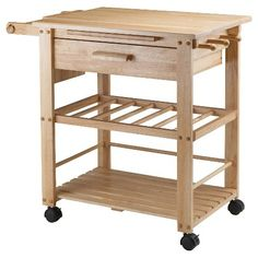 The Finland Kitchen Cart - Natural - Winsome is part business, part party. Station this portable cart in the kitchen for extra work space and storage, or wheel it into the living and dining areas to use as a bar or buffet. Three shelves are designed to hold wine bottles, kitchen items, or serving ware, just to name a few options. The surface is a great work space or serving area, and a built-in knife rack keeps things organized. Drape a hand towel on the built-in rack, and store tools and…