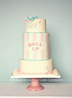 Funfair/fairground/circus themed pale pink and blue wedding cake - Funfair themed wedding cake for a photoshoot in pale pink and blue. Ruffle flower and board, striped middle tier with plaque. Little star cut outs to finish. I dont think I'll be handcutting this font again any time soon. TFL!