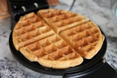"Cooked Whole Grain Waffle sub 1/4 cup quick oats (ground finely) for wheat germ.  Add 1 cup fruit and extra vanilla if desired.  Makes approx 2.5 ""4 square"" waffles."