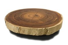 Bolacha Coffee Table    Made from beautiful reclaimed wood, the Bolacha Coffee Table is a heirloom-quality piece that is perfect to center your living space around. The round table top, showing the exquisite Tamburiuva wood grain, heightens the interest of the piece, making the visible rings a great conversation topic. What's the age of the wood?
