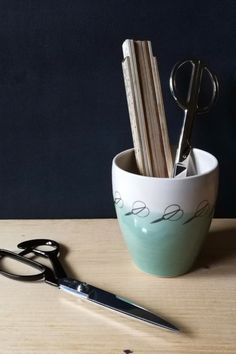 These gorgeous little ceramic pots are great for holding your tools and utensils.  Created in a collaboration between Christiane Kersten and Alison Milner, they are thrown individually and then decorated with glaze and transfers. #BeyondMeasure #sewing #storage #scissors #sewingroom Ceramic Pots, Utensils, Scissors, Diffuser, Collaboration, Glaze, Ceramics, Tools, Sewing