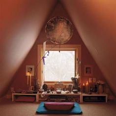 This was originally created to be a meditation/yoga room but I would switch it around to be a prayer room/war room. Absolutely LOVE the color and tat beautiful decoration at the top.