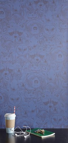 Sarah Watson's Menagerie/Wild print in Blue for Chasing Paper: Removable Wallpaper tiles. Add a bit of character to your walls!