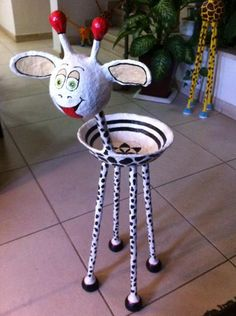 """White bowl giraffe"" by Yehuda Kariv"