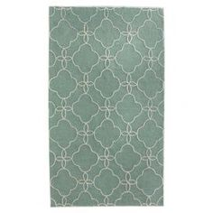 Hand-hooked wool rug in ocean with a quatrefoil-inspired trellis motif.  Product: RugConstruction Material: 100% PolyesterColor: OceanFeatures: Hand-tuftedNote: Please be aware that actual colors may vary from those shown on your screen. Accent rugs may also not show the entire pattern that the corresponding area rugs have.Cleaning and Care: These rugs can be spot treated with a mild detergent and water.  Professional cleaning is recommended if necessary.