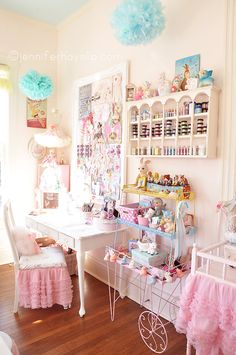 Eye Candy #Studio ~ Jennifer Hayslipi have that teacup shelf, and the white changing table. lvoe the skirts, and pom poms, whata fun craft room, my mom ahd that wire plant stand i wish i could find one liek it! we destroyed it as kids!  i liked it since i was 3 years old.