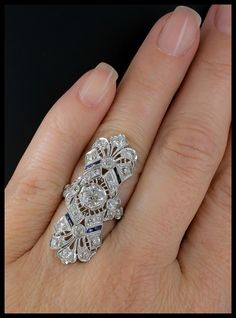 >>>Pandora Jewelry OFF! >>>Visit>> 【Jewelry in My Box】A magnificent antique Art Deco dinner ring at Lang Antiques. Sapphires and diamonds in platinum filigree circa Fashion trends Fashion designers Casual Outfits Street Styles Antique Engagement Rings, Antique Rings, Antique Jewelry, Vintage Jewelry, Antique Art, Antique Gold, Armoire Antique, Silver Jewelry, Black Jewelry
