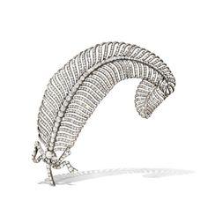 A sublime diamond set feather corsage, c1900.