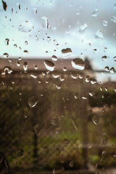 Trying to be creative on a wet day - Raindrops on window #WeeklyPhotographyChallenge