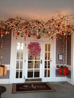 branches with lights and ornaments suspended from the ceiling. This is an outdoor entryway. (During the fall, pumpkins, etc. Christmas Branches, Hanging Christmas Tree, Cool Christmas Trees, Christmas Home, Christmas Lights, Bohemian Christmas, Christmas Crafts, Hanging Tree Lights, Christmas Ceiling Decorations
