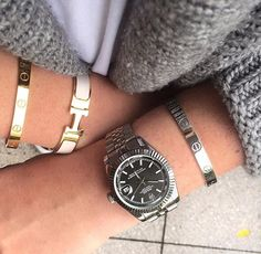 Love bracelet, Cartier. Hermes bracelet and Rolex watch