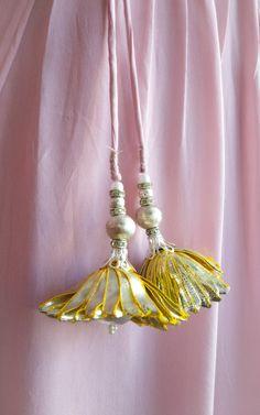 Gota tassels in Light Pink Gota Work tunic by Label Kanupriya Fancy Blouse Designs, Bridal Blouse Designs, Textile Jewelry, Fabric Jewelry, Saree Designs Party Wear, Saree Tassels Designs, Mehndi Designs 2018, Embroidery Fashion, Hand Embroidery Designs