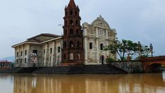 Standing majestically, surrounded by river is a replica of St. Note : still under construction . Vintage Houses, Bataan, St Joseph, Under Construction, Notre Dame, Philippines, Cathedral, Hotels, River